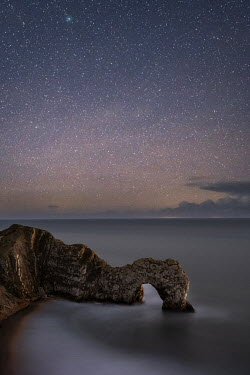 Ollie Taylor ARCH OF ROCK IN SEA AT NIGHT Seascapes/Beaches