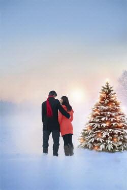 Lee Avison ROMANTIC COUPLE BY CHRISTMAS TREE IN SNOW Couples