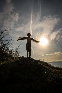 Stephen Carroll Boy with wings on hill Children