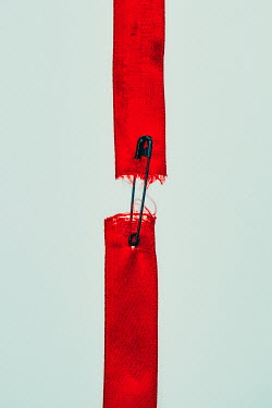 Magdalena Russocka torn red ribbon with safety pin