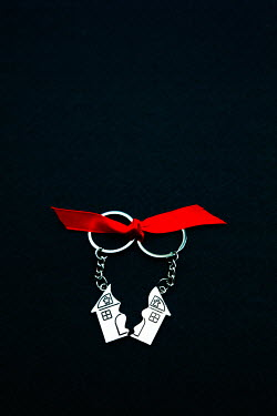 Magdalena Russocka divided house key rings with red ribbon