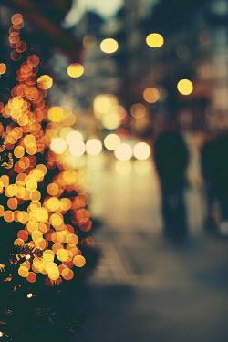 Irene Lamprakou PEOPLE IN CITY STREET WITH CHRISTMAS TREE Groups/Crowds