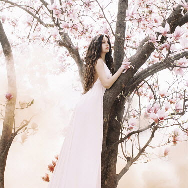 Jovana Rikalo BRUNETTE GIRL STANDING IN MAGNOLIA TREE Women