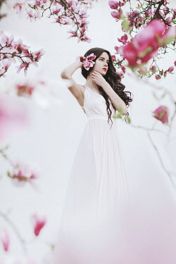 Jovana Rikalo BRUNETTE GIRL BY TREE WITH PINK FLOWERS Women