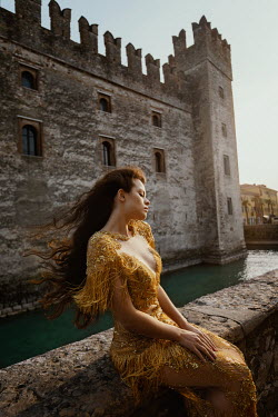 Tatiana Mertsalova GIRL IN GOLDEN DRESS SITTING BY CASTLE Women