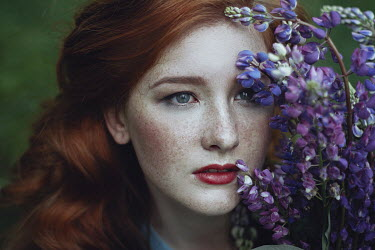 Irina Orwald WOMAN WITH RED HAIR AND PURPLE FLOWERS Women