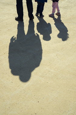 Mohamad Itani SHADOWS OF FATHER SON AND DAUGHTER OUTDOORS Groups/Crowds
