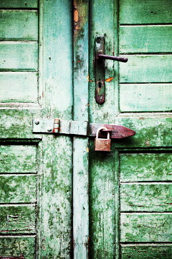 Irene Lamprakou Padlock on green old door Building Detail
