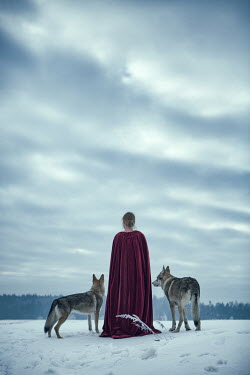 Magdalena Russocka historical woman with wolves standing in snowy field