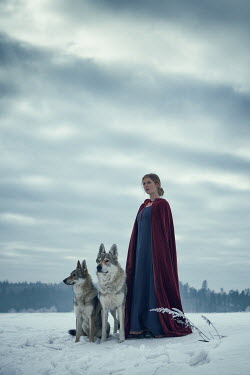 Magdalena Russocka historical woman with wolves standing in snowy field Women