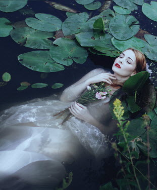 Irina Orwald WOMAN WITH FLOWERS FLOATING IN LILY POND Women