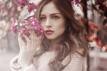 Greta Larosa BRUNETTE WOMAN OUTDOORS WITH PINK BLOSSOM Women