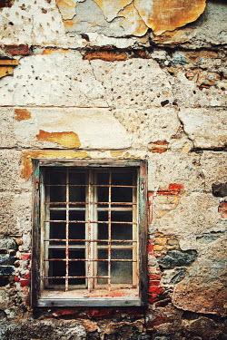 Irene Lamprakou RUSTY WINDOW IN OLD WEATHERED BUILDING Building Detail