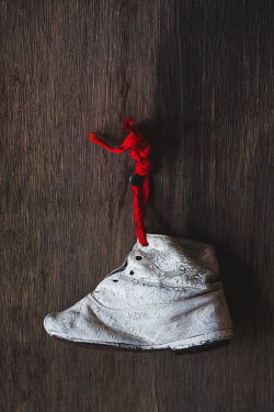 Magdalena Wasiczek OLD CHILDREN'S SHOE HANGING ON WALL Miscellaneous Objects