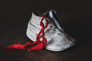 Magdalena Wasiczek OLD CHILD'S SHOE WITH RED LACE Miscellaneous Objects