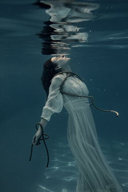 Rekha Garton WOMAN IN WHITE TIED WITH ROPES UNDERWATER Women