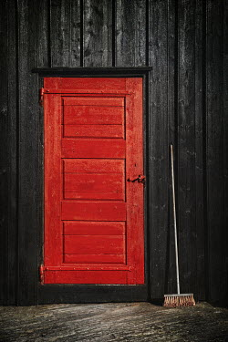 Evelina Kremsdorf EXTERIOR OF BUILDING WITH RED DOOR AND BROOM Houses