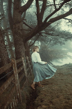 Rekha Garton WOMAN BY FENCE IN FOGGY COUNTRYSIDE Women