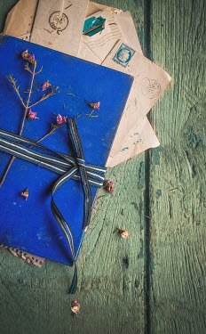 Jane Morley LETTERS TIED WITH FLOWERS ON WOODEN FLOOR Miscellaneous Objects