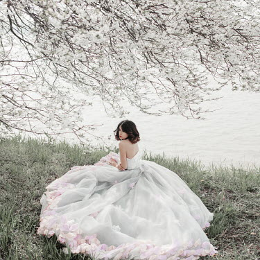 Jovana Rikalo Bride sat by blossom tree and water Women