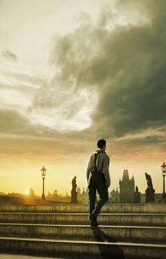 Stephen Mulcahey Retro man walking on city bridge at sunset Men
