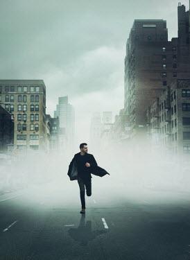 Mark Owen Man running through road in foggy city Men