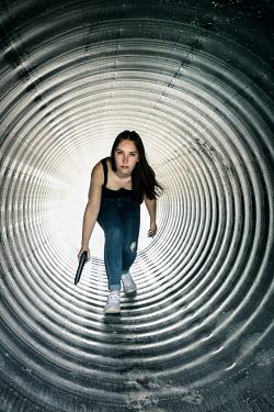 Stephen Carroll GIRL WITH GUN CROUCHING IN TUNNEL Women
