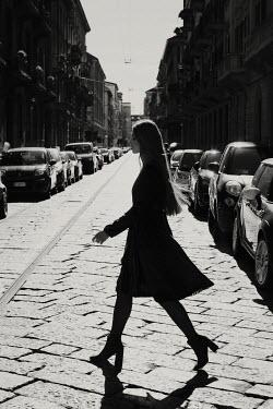 Giovan Battista D'Achille WOMAN WALKING IN SUNLIGHT URBAN STREET Women