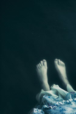 Magdalena Russocka close up of dead woman's feet in water