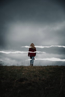 Rekha Garton GIRL IN STORMY COUNTRYSIDE WITH WHITE LINES Women