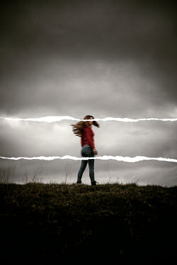 Rekha Garton WOMAN IN STORMY COUNTRYSIDE WITH WHITE LINES Women