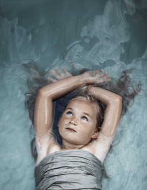 Robin Macmillan DAYDREAMING LITTLE GIRL FLOATING IN WATER Children