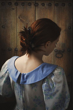 Robin Macmillan WOMAN WITH RED HAIR IN DRESS BY WOODEN DOOR Women