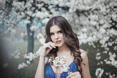 Nadja Berberovic BRUNETTE WOMAN BY TREE WITH WHITE BLOSSOM Women