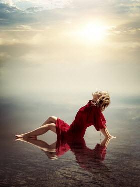 Elisabeth Ansley WOMAN IN DRESS LYING IN SUNLIT WATER Women