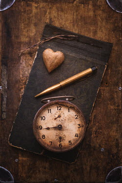 Magdalena Wasiczek RUSTY CLOCK WITH PEN AND HEART ON ALBUM Miscellaneous Objects