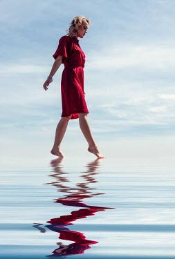 Elisabeth Ansley WOMAN WALKING TIPTOE IN TRANQUIL WATER Women