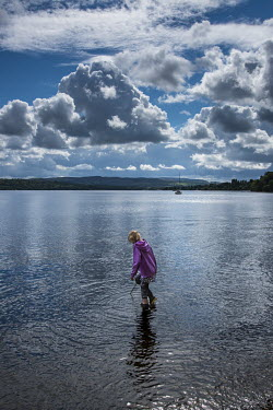 Tim Gartside YOUNG GIRL PADDLING IN WATER Children