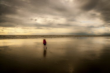 Tim Gartside YOUNG GIRL WALKING ON SANDY BEACH Children