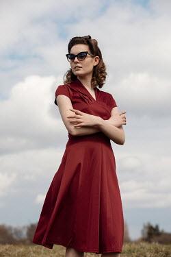 Rekha Garton RETRO WOMAN IN RED DRESS AND SUNGLASSES Women