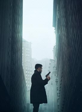 Mark Owen MAN HOLDING GUN IN CITY Men