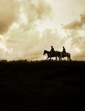 Stephen Mulcahey SILHOUETTE OF OFFICER AND WOMAN ON HORSES Couples