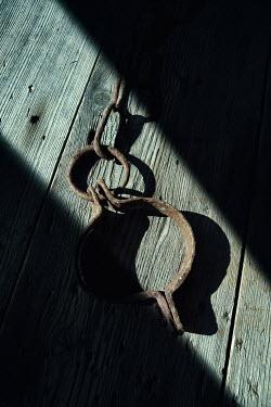 Magdalena Russocka old shackle on wooden boards