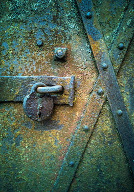 Jaroslaw Blaminsky RUSTY PADLOCK ON METAL DOOR Building Detail