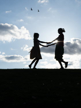 Elisabeth Ansley Two girls' silhouettes holding hands Children