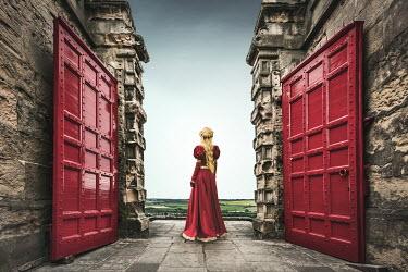 Evelina Kremsdorf HISTORICAL WOMAN STANDING BY CASTLE GATES Women