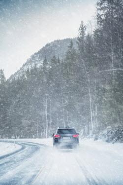 Evelina Kremsdorf CAR DRIVING ON SNOWY MOUNTAIN ROAD Cars