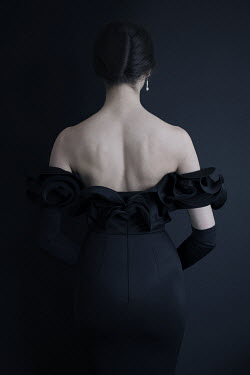 Iness Rychlik WOMAN IN BLACK EVENING GOWN FROM BEHIND Women