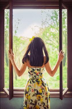 Svetoslava Madarova WOMAN IN FLORAL DRESS OPENING WINDOW Women