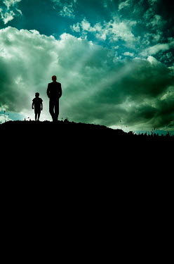 Valentino Sani SILHOUETTED FATHER AND SON ON HILL AT DUSK Children
